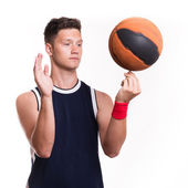 Basketball player spins the ball on his finger — Stock Photo