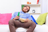 Sleeping at a party with popcorn and beer — Stock Photo