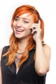 Red-haired young girl laugh on a smartphone — Stock Photo