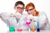 Two students in chemistry lab doing reactions — Stock Photo
