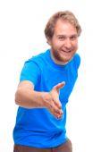 Cheerful man gives hand to handshake — Stock Photo
