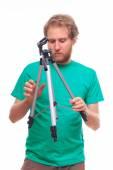 Man unfolding a tripod  — Stock Photo