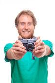 Portret van vrolijke fotograaf met camera — Stockfoto