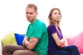 Offended boy with a girl on the sofa at home  — Stock Photo