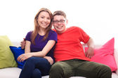 Boy and girl on the sofa — Stock Photo