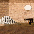 Medieval cannon and balls — Stock Photo #59477289