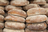 Large loaves of bread in a bakery — Stock Photo