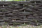Braided wicker fence in the countryside — Stock fotografie