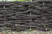 Braided wicker fence in the countryside — Stock Photo