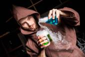 Alchemist in chemical laboratory prepares magical liquids — Stock Photo
