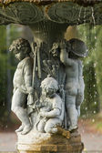 Ornamental fountain with figures of children in the garden  — Stock Photo
