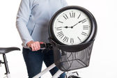 The clock in the bicycle basket  — Stock Photo
