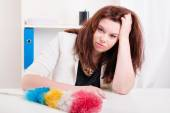 Woman with brush does not have strength to clean up dust  — Stock Photo