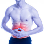 Muscular man has strong abdominal pain — Stock Photo