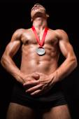 Muscular sportsmen with medal on his chest  — Foto Stock