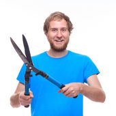 Portrait of bearded man with pruning shears — Stock Photo