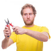 Handyman holding pliers  — Stock Photo