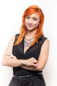 Smiling pretty and young girl with red hair — Stock Photo