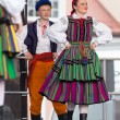 Folk dancers from city of Lowicz in traditional costumes — Stock Photo #61303427