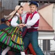 Folk dancers from city of Lowicz in traditional costumes — Stock Photo #61303431