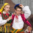 Folk dancers from city of Lowicz in traditional costumes — Stock Photo #61303435