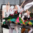 Folk dancers from city of Lowicz in traditional costumes — Stock Photo #61303753