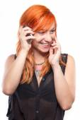 Pretty redhead girl laughing into the mobile — Stock Photo
