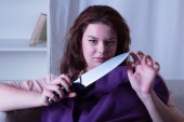 Dangerous woman with a knife in his hand — Stock Photo
