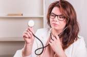 Young female doctor with a stethoscope examine — Stock Photo