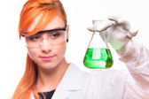Chemist woman holding a test tube in a lab — Stock Photo