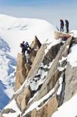 Alpine climbers climbing on a rock — Stock Photo