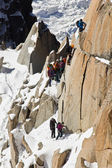 Alpine climbers climbing on a rock — Stock Photo