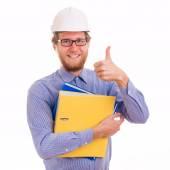 Young happy engineer in helmet — Stock Photo