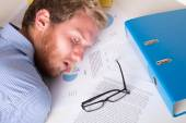 Worker asleep with his head on the desk — Stock Photo