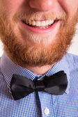 Smiling bearded man with a bow tie — Stock Photo