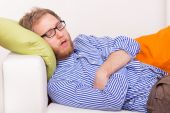 Young man sleeping on the couch — Stock Photo