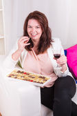 Plump women eat and drink with abandon — Stock Photo