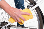 Spring cleaning of the bike frame with a cloth — Stock Photo