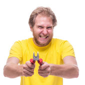 Bearded man holding pliers — Stock Photo