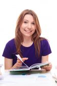 Girl learning  and smiling — Stock Photo