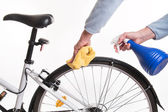 Hands with a cloth and water cleaning bicycle fender — Stok fotoğraf