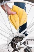 Cleaning bicycle spokes in the wheel with a cloth — Stok fotoğraf