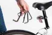 Adjustment and repair of the bike with the allen key — Stock Photo