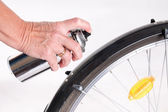 Woman paints the bike fender with spray — Stock Photo
