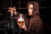Alchemist in chemical laboratory — Stock Photo