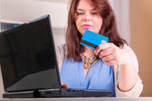 Woman paying with credit — Stock Photo