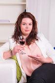 Elegant woman drinking wine — Stock Photo