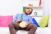 Sleeping man sitting at TV — Stock Photo