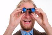 Excited man watching through binoculars — Stock Photo