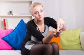 Woman resting in front of TV — Stock Photo